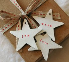 I love my holiday tags to be different like these. Cut out cardboard stars, use cookie cutter as guide if need to and use those eye things in offiice supply area or paper puncher and done