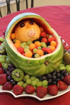 Watermelon Fruit Basket/Bassinet With Baby in the Stroller. cute Baby Shower idea.