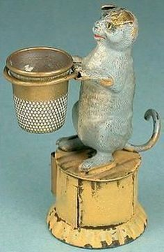 Circa 1900's - Cat Thimble Holder and Tape Measure.