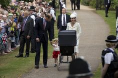 William looks to be assuring his young son, while Kate beamed as she pushed her daughter i...