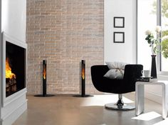 Niall | Decorpro  Halfway along the length of an exposed brick wall, Niall torch's mid-range height stylishly accents a modern living space. Helping to define feature pieces such as the contemporary fireplace delicate pieces of artwork and a pedestal chair, Niall is a nifty and functional torch. (Each and Base and Fuel sold separately.)