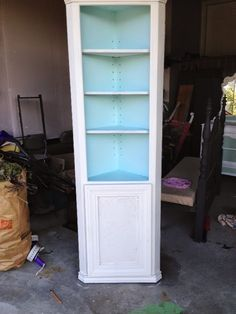 This secondhand corner shelf got a pretty makeover with white and aqua paint and the addition of a door for some hidden storage! Types Of Furniture, Paint Furniture, Furniture Making, Furniture Makeover, White Corner Cabinet, Corner Shelves, Book Cabinet, Cabinet Ideas, Shelf Makeover