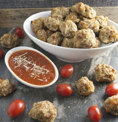 A new twist on Sausage Balls! Italian Sausage Balls dipped in warm marinara are the perfect appetizer! www.maebells.com