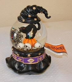 Halloween LED Lighted Witch Hat Cat on Pumpkin Skulls Water Snow Globe 7  I have always loved snow globes they are enchanting, majestic and super cool.  I love that they are a rare novelty item that has a history and nostalgic meaning. They make great home decorative accents and can be used in every room of the home. Holiday snow gloves are some of my favorite.   They make excellent gifts and I love the wide variety there are.