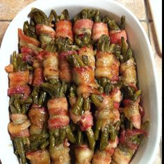 Our family new favorite dish. Green Beans wrapped in bacon with a brown sugar butter sauce drizzled on top and baked. Oh so yummy! Even the guys at the Firestaion ask for it! Green Bean Wrapped In Bacon Recipe, Green Beans With Bacon, Bacon Recipes, Vegetable Recipes, Food Places, Vegetable Side Dishes, Side Dish Recipes, Easy Cooking, Thanksgiving Recipes