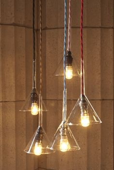 Lights from salvaged glass chemistry funnels. Retrouvius Reclamation and Design.