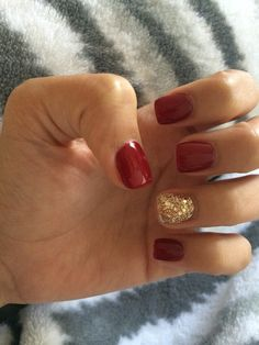 Deep red nails with gold accent. Absolutely love!!!