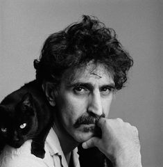 Frank Zappa and his black kitty. I trust a man who likes cats. Cheers to you, Frank!