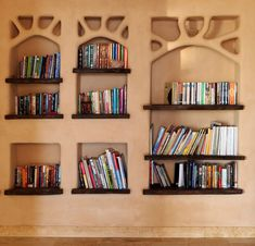 "Built-in Cob bookcase and more mud ""Bottz group"""