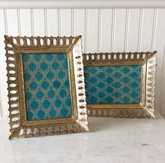 This is a set of two 5 x 7 gold metal ornate frames. Both have original glass, red ( burgundy) velvet backs with easel & hooks for hanging. Both in good vintage condition! Great for weddings, baby /bridal showers, special occasion, or gallery walls! Frames can go horizontal or vertical. Measures each 9 x 7 total ( fits a 5 x 7 picture)  Thanks for shopping YellowHouseDecor!  Several frames sold in shop, convo if you wish to purchase more than one item for reduced shipping cost