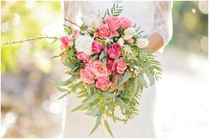 Garden esque hot pink wedding bouquet with double tulips and roses