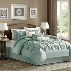 Bring a touch of texture to your guest room or master suite with this eye-catching comforter set, featuring a pieced design and seafoam green hue.