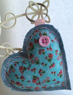 Handmade Fabric Keyring    This heart is made from light blue denim with a pretty blue floral cotton fabric on top. The heart has been padded with a