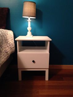 IKEA hack Tarva nightstand. Painted white for contrast of dark teal and gray walls.
