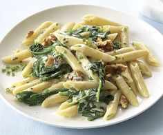 PENNE W/ SPINACH,GORGONZOLA & WALNUTS   Kosher salt 8 oz. fresh baby spinach leaves (10 lightly packed cups) 1/4 cup coarsely chopped walnuts 12 oz. dried penne (3-1/2 cups) 3/4 cup heavy cream 2-1/2 oz. crumbled Gorgonzola (1/2 cup) Freshly ground black pepper 3 Tbs. thinly sliced fresh chives