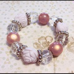 """Super chunk super fun white and pink bracelet Chunky fun bracelet featuring white roses, crystal clear and Rose wonder acrylic beads with silver accents. Fits 7"""" wrists on super stretchy clear power cord.. Sayre Jewelry Bracelets"""