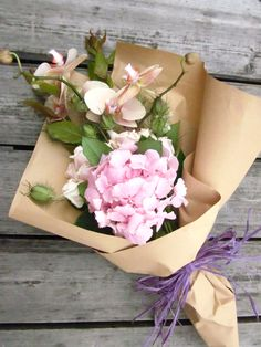 flowers wrapped in brown paper