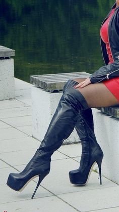 Black leather boots and jacket + red dress