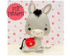 This PDF hand sewing pattern will give you instructions and patterns to make the donkey pictured    Size: 7 approximately.    Language: English   THIS