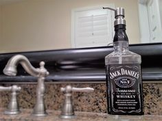 Jack Daniels Whiskey soap dispenser for your bathroom hand soap or kitchen dish soap. The perfect Jack Daniels gift for dad, boyfriend or a whiskey lover! This will be your new favorite soap dispenser! Jack Daniels Decor, Jack Daniels Bottle, Bathroom Soap Dispenser, Soap Dispensers, Glass Spray Bottle, Glass Bottles, Plastic Bottles, Jack Daniels Soap Dispenser, Whiskey Dispenser