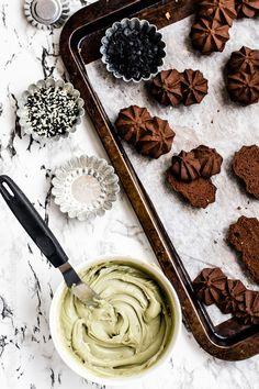dark chocolate sable with black salt green tea ganache