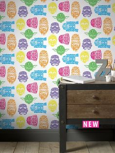 Graham & Brown Star Wars Neon Head Wallpaper Brighten up their bedroom and give it a look from a galaxy far, far away with this vibrant Star Wars wallpaper by Graham & Brown. Against a white canvas it features a unique print with different characters from the iconic sci-fi films all made from neon wording. Yoda is described as a Great Jedi Master, Darth Vader is signified by Dark Side and Chewie even has his signature Growl! Pair with the matching Neon Canvas, available separately (se...