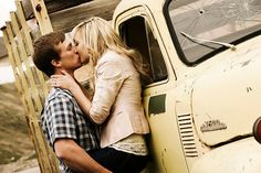 Kissing Against a Truck.