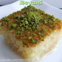 "Revani Semolina cake soaked in sweet syrup and topped with pistachio … in Arabic we call it ""Haressa"" Turkish Sweets, Greek Sweets, Greek Desserts, Lebanese Recipes, Turkish Recipes, Greek Recipes, Bar Recipes, Arabic Dessert, Arabic Food"