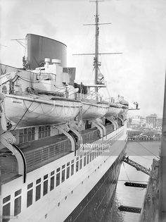 The North German Lloyd Liner Bremen, arrived at Southampton to be towed into the dry dock for overhaul and repainting.