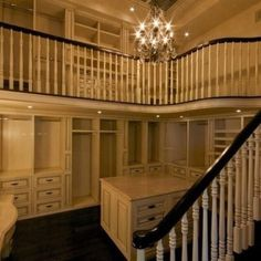 Master bedroom closet. This would be so amazing to have as a closet for a couple :) One floor can be for him and the other floor can be for her                                                                                                                                                     More