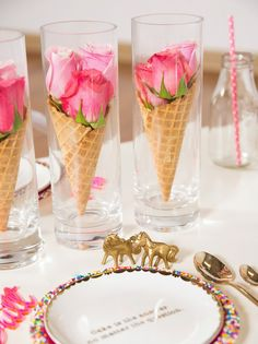 UNICORNS & SPRINKLES ~ Waffle cones filled with roses in different shades of pink placed delicately in clear glass keep the centerpiece clean while still visually stimulating. | Glossed the Blog