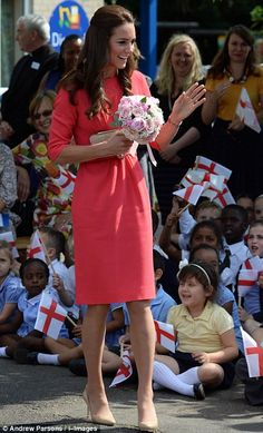 Kate wore a pink dress by Goat and nude heels
