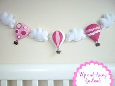 This pretty hot air balloon garland can be hung almost anywhere!  Made up of 3 plump hot air balloons in shades of pink and white with 4 plump white clouds.  Squished together or spaced apart, there is over 2m of sheer white ribbon to tie where you wish.   Hang in baby's nursery or child's bedroom, ...