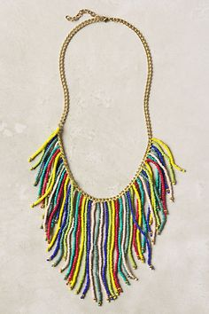 I'm totally going to steal the idea and try to recreate this Anthropologie necklace. Perfect for the summer
