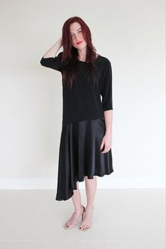 Modest black dress with high neckline and elbow length sleeves. With an  asymmetrical hem. 7d57f21ccbf3
