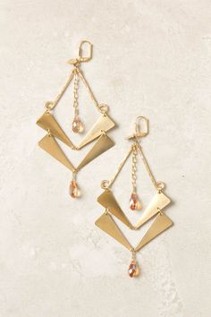 Golden Guillemet Earrings from Anthropologie.com    14k gold filled + 24k gold plated brass- negative space looks great in these
