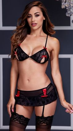 This sensual set features a black lace peek-a-boo bra with adjustable spaghetti straps, red bow accents, and a black garter skirt with red lace-up detailing, tie back, and adjustable garters. (Thigh highs and panty not included.) Peek A Boo Bra and Garter Skirt Set, Bra Garter Set, Black Bra and Garter Set #lingerie #valentinesdaylingerie #brasets