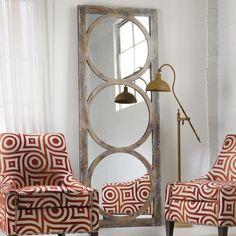 Floor mirror with circle overlay detail.   Product: Floor mirrorConstruction Material: Hardwood solids, pine veneers, ...