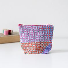 Digitally printed linen zipped pouch. Illusion by PixelAndThread
