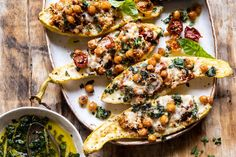 Making use of all the summer produce with this Spicy Chickpea and Cheese Stuffed Zucchini. A healthy vegetarian recipe made with crispy spicy chickpeas and tomatoes, all stuffed inside herb-roasted cheesy zucchini. This simple sheet pan recipe doubles as both a healthy dinner and a simple side dish. Either way, you serve it up, it's … Easy Summer Dinners, Easy Meals, Vegetarian Recipes, Healthy Recipes, Tofu Recipes, Avocado Recipes, Salmon Recipes, Chickpea Recipes, Spinach Recipes