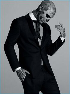 Rick Genest cuts a sartorial figure in a Tonello suit with a Hugo Boss shirt and Maison F tie.