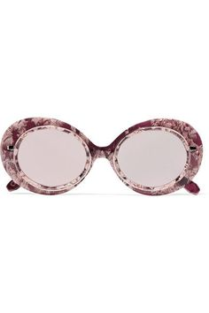 KREWE's 'Iris' sunglasses are inspired by New Orleans' Mardi Gras. This round pair is hand-carved from marbled acetate and finished with a custom-made rose gold-tone metal wire rim and arms. The mirrored lenses add to the eclectic feel.