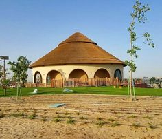 Beautiful Cape Reed thatched roof at Dubai Safari Park! Thatched House, Thatched Roof, Dubai Safari, Zoo Architecture, Mud Hut, Farm Layout, 4 Bedroom House Plans, Home Design Floor Plans, Farm Cottage