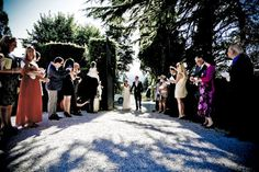 Bride and groom arriving through the gates. Wedding at Villa Di Ulignano near San Gimignano in Tuscany. Outside wedding, by the pool with views of vineyards and rolling landscape #wedding #italy #tuscany