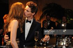 Winner for Best Actor Eddie Redmayne kisses his wife Hannah Bagshawe at the Governor's Ball following the 87th Oscars (February 22, 2015) iin Hollywood, California.