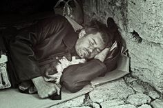 Homeless man sleeping with his dog one day at Koules castle