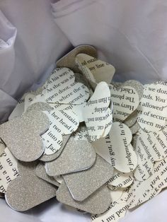 Screw flower petals for flower girls. I'm doing this! =D Maybe with scrapbook paper and books.