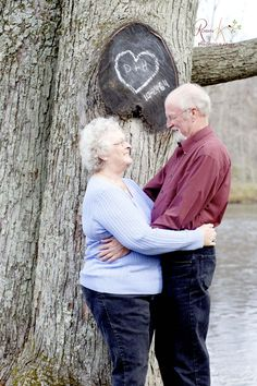 a couple who have been celebrating 50 years of marriage with their names carved in the tree