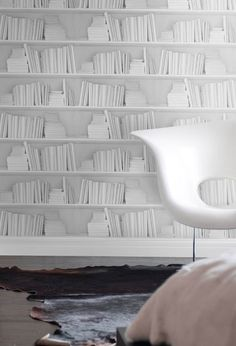 Bookshelf Wallpaper Create a heavenly library look with this gorgeous white colour bookshelf wallpaper designed by Young & Battaglia for Mineheart. This Bookshelf wallpaper features white books on white shelves for a bright minimalist look. Book Wallpaper, White Wallpaper, Print Wallpaper, Original Wallpaper, Wallpaper Bookshelf, Bookshelf Wall, Bookshelf Ideas, Bookshelf Design, Wallpaper Designs