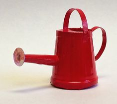 Learn how to make a miniature watering can from commonly found objects.